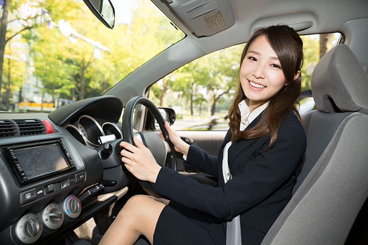 asian woman in car
